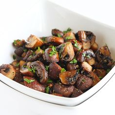 Easy Roasted Mushrooms with Rosemary & Garlic. Substitute coconut oil to make it Slenderiiz-approved.
