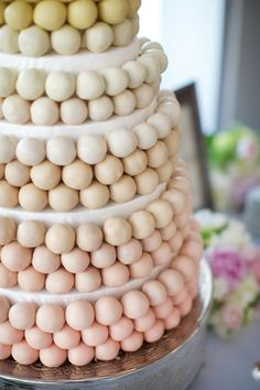 I love this cake ball idea! Very much like the French wedding cake croquembouche