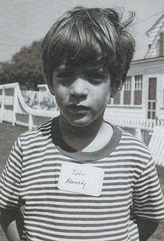john f kennedy jr  -  I love this picture!  Was the name sticker for those who lived on the dark side of the moon?