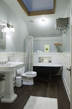 Traditional Full Bathroom with Wall sconce, Toto drake ii two piece toilet, Laminate floors, Clawfoot Bathtub, Pedestal Sink