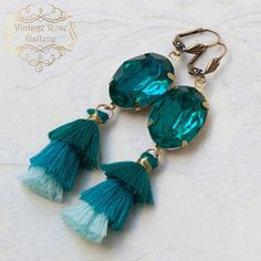 Aqua Tassel Earrings, Boho Tassel Earrings, Boho Chic Earrings , Bridesmaid Gift Features oval aqua crystals into bronze settings, cotton triple aqua tassels , and antique bronzer lever back ear hooks. Measures approx. 3 1/2 - 9 cm in length. A real gorgeous pair of earrings