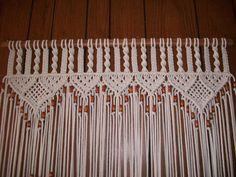 Macrame knotting design is 12 inches from top of curtain loops to the Square Knot under the weaved triangle shape in both styles. Description from etsy.com. I searched for this on bing.com/images