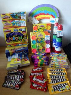 Some of the prizes we gave during our children's rainbow art party - play dough, stacking cups for babies, oil pastel set for primmies, candies for adults
