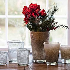DutZ vase with amaryllis and some pine twigs