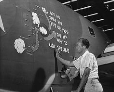 George McCraw, worker at Vega Aircraft Corporation, applying nose art on a PV-1 Ventura aircraft, Burbank, California, United States, c. May 1942