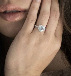 Heart Shape Cut Aquamarine Diamond Solitaire Ring. $1,280.00, via Etsy.