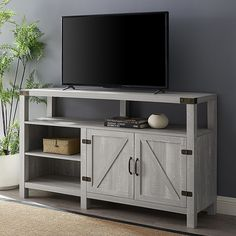 Featuring farmhouse style, the Barndoor Highboy Console from Forest Gate makes a charming addition to any family room. Features a country barn door style cabinet for concealed storage and spacious open shelves for display or media storage. Media Furniture, Living Room Furniture, Open Shelving, Adjustable Shelving, Highboy Tv Stand, Tall Tv Stands, Universal Tv Stand, Farmhouse Cabinets, Modern Farmhouse Style