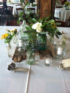 Mixed bottles and jars wood wedding centerpiece KP Event Design Kansas City