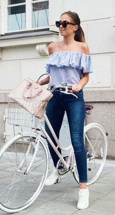 Vacation style. For France, love the crop jeans and frilly shirt