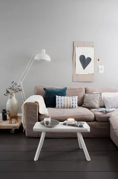 Neutral colored living room. And of course a heart on the wall.