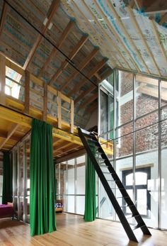 An amazing contrast between the modern open interior to the old industrial facade and building shape. Look at all the pictures to appreciate this conversion.   www.archdaily.com...