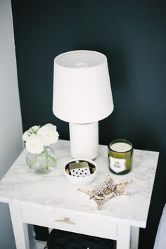 #nightstand, #bedside-lamps, #side-table Photography: Heidi Lau - www.heidilau.ca View entire slideshow: Prettiest Side Tables Ever on http://www.stylemepretty.com/collection/1122/
