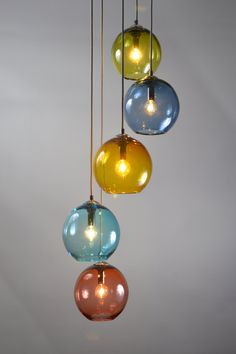 The multiple colored Gumball Cluster Pendant offers elegance and originality. The hardware is custom made by my partner, Terence Dubre of Paradoxart. Every facet of this chandelier is made by us in our Central Falls, RI studio. We do not outsource anything. The hardware is not stamped steel. The canopy is welded and fabricated from 1/8 inch thick steel , then primed and painted with a high quality paint in our studio. We intend to work with you, our client, to create the best lighting a...