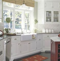 Kitchen:  Farmhouse sink with a view!  My dream kitchen will have lots and lots and lots of cabinet and counter space!  I love the all-white cabinets, with a few glass fronts to let my most prettiest dishes peak through.