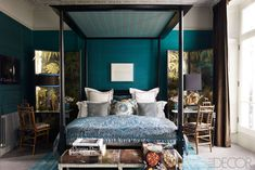 The teal is intriguing - with the screens, canopy, and bamboo chairs - it feels so tranquilly tropical!