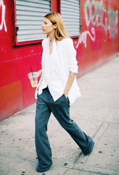Untuck your shirt over wide-leg pants.