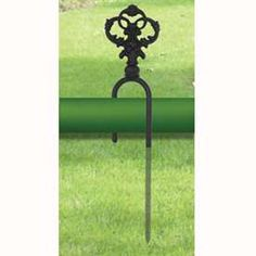 Wrought Iron Decorative Hose Guide keeps your garden hose out of the way and off your flowers!