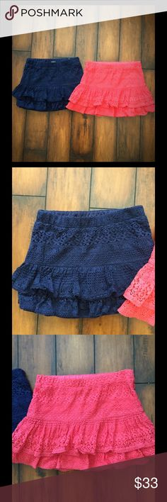 Justice bundle of lace tiered skirts (girls) Justice skirts. Soo cute, I had to have them in two colors! One is navy blue & the other is coral. They are a lace tiered skirt. Size 14 girls Justice Bottoms Skirts