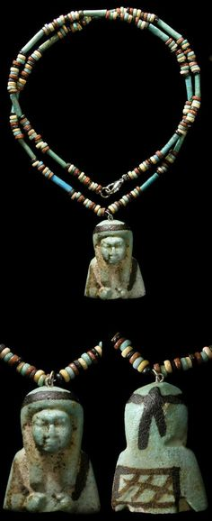 Egypt, Late Period, 664-535 BC. blue, red, black and green faience disc and tube beads. Strung with a large and highly-detailed torso of an ushabti. | 575$ ~ Sold, alternate available