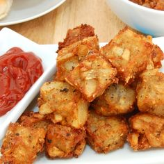 Homemade Crispy Potato Tots (Tater Tots)  1 cup water  2 1/4 teaspoons salt  2 1/2 pounds russet potatoes, peeled and cut into 1 1/2-inch pieces  1 1/2 tablespoons all-purpose flour  1/2 teaspoon pepper  1/8 teaspoon cayenne pepper (optional)  4 cups peanut oil or vegetable oil