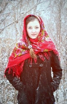A girl in the Russian Pavlovsky Posad shawl is walking in the winter park during the snowfall. #folk #beauty #Russian #shawl