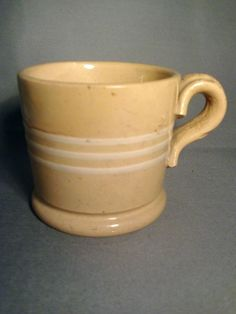 Yellow ware.  I grew up surrounded by all kinds of redware, yellow ware, spongeware, etc.  Loved it.