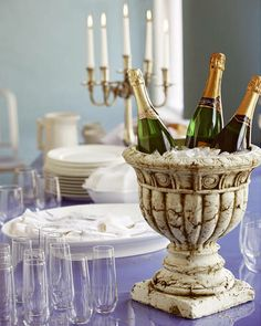 Urn for champagne bucket. ELLE DECOR