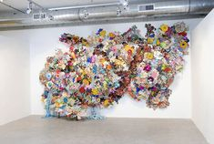 Frosted Pink Lipstick Smeared All Over His Face (cloth, wood, pipes, flanges, embellishments 20' x 10' x 5' - 2010) Jesse Harrod