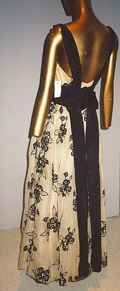 """Dress, Evening  House of Chanel (French, founded 1913)  Designer: Gabrielle """"Coco"""" Chanel (French, Saumur 1883–1971 Paris) Date: 1937 Culture: French Medium: silk Dimensions: Length at CB: 43 1/4 in. (109.9 cm) Credit Line: Gift of Mrs. Harrison Williams, Lady Mendl, and Mrs. Ector Munn, 1946"""