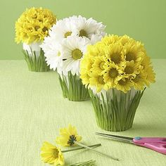 """YOU'LL NEED (makes 1 pot):  Scissors  Ruler  Glue lines (save-on-crafts.com)  White flowerpot, 4½"""" diameter 4"""" blades of fresh-cut grass  Floral foam sphere, 4½"""" diameter (save-on-crafts.com)  1 to 2 dozen daisies, depending on size of flowers"""