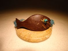 Coconut Fish and Crystal Bracelet by MysticTrove on Etsy