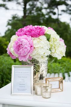 This white and pink peony display is absolutely stunning when paired with silver accents.