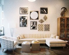 An art grouping above a beige sectional