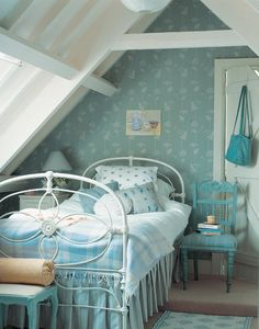A lovely iron bed--I like the monochromatic color scheme too--and the wall paper pattern