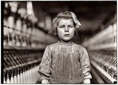 ~child laborer in a mill~By Lewis Hine ~undereducated, uneducated, poorly paid, overworked, no safety regulations, diseases & injuries~