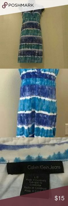 "Calvin klein tie dye striped dress Calvin klein women's tie dye blue & white striped dress. Stretchy comfortable fabric. 95% cotton, 5% elastane. 35 1/2"" long. In great used condition. Calvin Klein Dresses Midi"