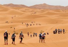 Competitors cross the Dunes of Merzouga south of the Moroccan town of Ouarzazate, during the Marathon des Sables. The 844 self-sufficient participants run - or walk - during seven days in the Moroccan Sahara. The Dunes, Amazing Destinations, Trail Running, The Great Outdoors, Morocco, Kayaking, Adventure Travel, Monument Valley, Chihuahua