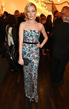 Arriving at the Evening Standard 2016 Theatre Awards, British model Clara Paget wearing a watercolour rose Burberry dress
