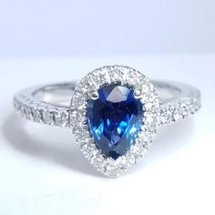 Material: 18K White Gold Center Stone: Sapphire 1.69ct Royal Blue Hue Diamonds: 0.40ctw Quality: F-G color, VS-SI clarity
