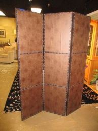 """Price: $440.00 Item #: 40720 Brown leather three panel screen with nail head trim. Each panel measures 18""""wide x 72'tall."""