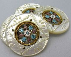 Four Large Mother of Pearl Buttons with Beautiful Floral Enameled Centers.