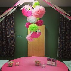 Cluster above candy/food table. Tissue paper flowers and owl lanterns!