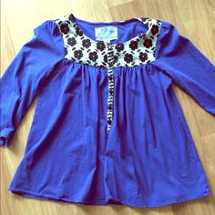 HP  Anthropologie blue peasant top  Adorable royal blue anthro top by Deletta with black flower embroidery. Unfortunately, there are small holes under both armpits (see picture!) Anthropologie Tops