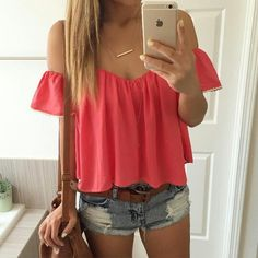 Coral flowy shirt and ripped jean shorts