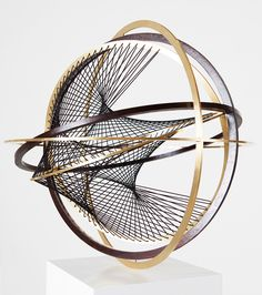Timo Nasseri Kaon 2015,Brass, wood, rubber strings49 x 49 x 49cm