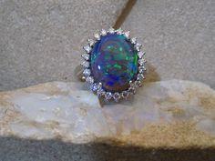 A ring for an empress! Dark Crystal Opal, deepwater sea colors, diamonds and 18 carat white gold. #lightningridgeopalmines #melbourne #63elizabethstreet  www,opals.net.au