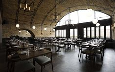 Beagle Restaurant in London........Each arch represents a different seating area (the steel straps that arc across the restaurant ceiling was inspired by Victorian railway cars, which were framed in metal hoops). Photo via The Telegraph.