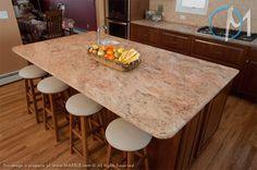The light patterns throughout Vyara Gold bring flow through this kitchen.