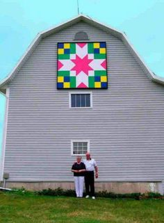 Couple with a block on a barn