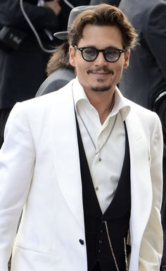 Johnny Depp his expression is like teehee